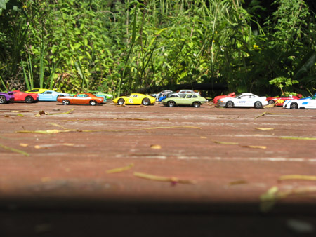 Here's a Saturday traffic reenactment for you, staged by Hot Wheels on our deck.